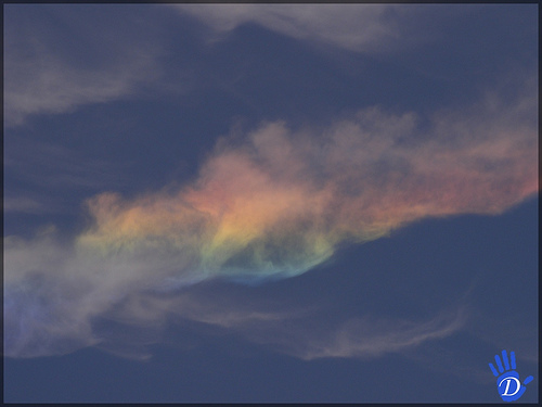 Dark sky indicates reduced exposure, necessary bring rainbow into dynamic range of the sensor.